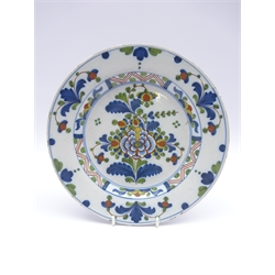 18th Century English Delft plate decorated with stylised flowers in blue, green and red, D23cm