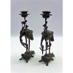 Pair of Chinese bronze 'Crane and Turtle' candlesticks, 19th Century, each cast as a crane standing on the back of a mythical formed turtle with a lotus stem in its beak, circa 1820 H 27cms-  Soame Jenyns Collection