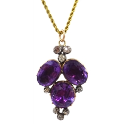 14ct gold amethyst and diamond pendant on gold rope twist chain necklace, stamped 15ct