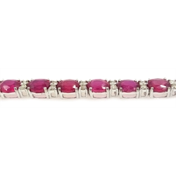 Ruby and diamond 18ct white gold line bracelet, stamped 750, rubies approx 13.3 carat, diamonds approx 0.7 carat