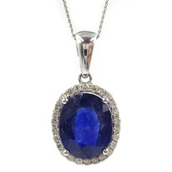 White gold oval sapphire and diamond pendant stamped 14K on 9ct white gold chain, hallmarked