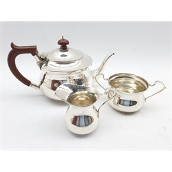 Silver three piece tea set of circular form, the teapot with stained handle and lift Birmingham 1939 Maker S Blanckensee & Son Ltd 18.9oz