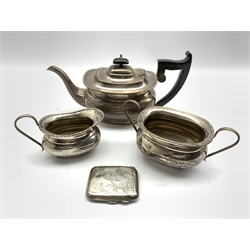 Silver three piece tea set with egg and dart border, the tea pot with ebonised handle and lift Sheffield 1931 Maker Viners and an engraved silver cigarette case 42.5oz gross