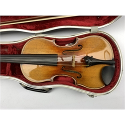 German violin by Albin Ludwig Paulus, labelled A L Paulus, Violin Maker to the Royal Court of Saxony, Dresden with two piece back, length of back 37cm together with a bow stamped Conrad Gotz