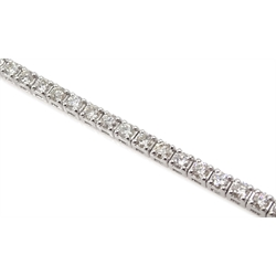 White gold diamond line bracelet, stamped 18K, total diamond weight 2.70 carat