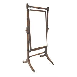 Mahogany Cheval mirror circa 1820, with ring turned supports and stretchers raised on splayed base with brass cup castors, 83cm x 175cm