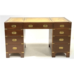 20th century Campaign style mahogany twin pedestal desk,  the top with inset  tooled  leather writing surface over one long and eight short drawers with recessed brass handles, raised on shaped bracket supports, 137cm x 68cm, H78cm