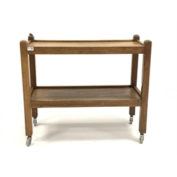 'Mouseman' Yorkshire oak tea trolley, two tiers raised on square supports terminating in castors, carved with mouse signature, 85cm x 38cm, H74cm