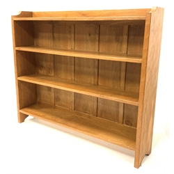 'Eagleman' oak open bookcase, with adzed and shaped panel end supports supporting three shelves, W127cm, H107cm,  D25cm