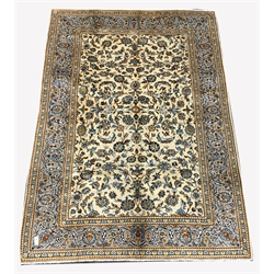 Persian fine Kashan ivory ground carpet, with repeating floral motif enclosed by multi line border,  288cm x 202cm