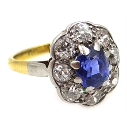 Gold oval sapphire and old cut diamond cluster ring, stamped 18ct