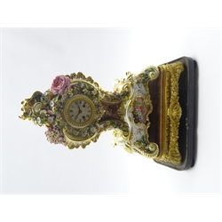 19th century Rococo style porcelain mantel clock, cartouche shaped with hand painted flower head and foliage decoration, on stand initialled 'J.P (Jacob Petit)', engine turned silvered Roman dial, twin train movement striking on bell, signed on back plate 'Douillon, 2313', 'Pepin Paris', gilt wood and gesso stand decorated with shells and floral swags, ebonised plinth, under glass dome, H59cm
