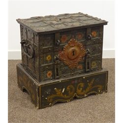 17th century iron Armada chest, probably German, heavily strapped and riveted with carrying handles, locking mechanism having six latch bolts behind plate, floral painted decoration, on later stand, W53cm, H51cm, D40cm (including stand), W50cm, H35cm, D37cm (chest only)