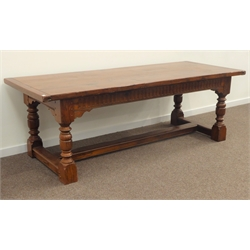 Large 18th century style oak refectory table, cleated planked top on arcade carved frieze, turned and block supports joined by a floor stretcher, 230cm x 90cm, H77cm