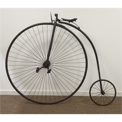 Victorian penny-farthing or high wheeler ordinary bicycle, iron framed black painted with gold lining, handles bars with turned fruitwood hand grips, leather saddle on iron suspension strap, leaver brake to fork stem, large spoked front wheel and trailing wheel with solid rubber tyres, mounting peg above rear wheel, the tyres stamped '1
