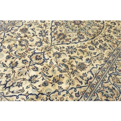 Persian Kashan rug, ivory ground with blue interlacing design, 250cm x 150cm