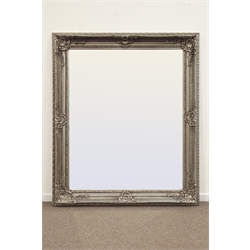Large rectangular bevelled edge wall mirror in ornate swept silvered frame with shell and leaf decoration, 170cm x 200cm