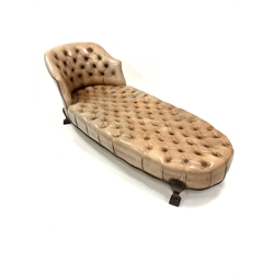 Georgian style chaise longue, with tub shaped raised back rest, upholstered in deep buttoned and studded leather, raised on lobe carved walnut supports, L200cm, H75cm, D80cm
