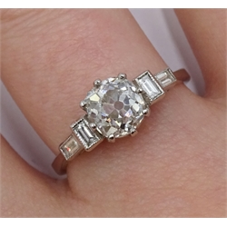 Platinum old cut diamond ring, with baguette diamond shoulders, stamped plat, central diamond approx 1.20 carat