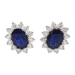 Pair of white gold sapphire and diamond cluster stud earrings, stamped 18K, total sapphire weight approx 2.00 carat, total diamond weight approx 0.75 carat