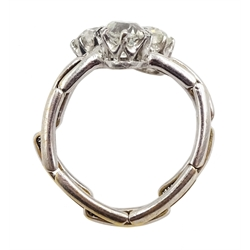 Early 20th century platinum three stone old cut diamond ring, on later 17ct white gold expanding shank, total diamond weight approx 1.35 carat