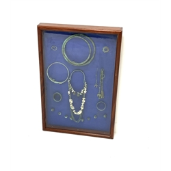 Set of Viking high status ladies personal jewellery mounted in a mahogany glazed display case, 61cm x 91cm