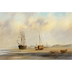 David C Bell (British 1950-): 'A Yorkshire Coastal Scene' - Vessels at Low Tide, oil on canvas signed, titled verso on gallery label 50cm x 75cm 
