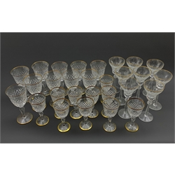 Part suite of Stuart Crystal Hardwicke pattern glasses with gilt rims, comprising ten large claret glasses and ten small claret glasses, together with a set of eight Spode crystal hock glasses with gilt rims (28)