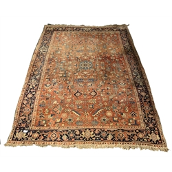 Persian design carpet, with geometric design on red field, guarded border, 254cm x 340cm