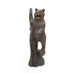 Black Forest carved wooden figure of a standing bear holding a branch H103cm