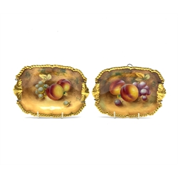 Pair of Royal Worcester hand painted rectangular dishes, each decorated with grapes and peaches within gilt gadrooned borders and shell handles, each indistinctly signed, 17.5cm x 12.5cm
