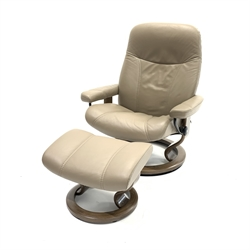 Ekornes Stressless leather upholstered reclining armchair with stool