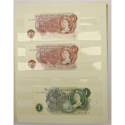 Album containing Bank of England notes including two Fisher one pound notes 'M1 50 No.125550' and 'P1 89 No.525053', various Peppiatt ten shilling and one pound notes, varying grade throughout with some being uncirculated or close to uncirculated and various modern polymer notes