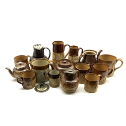 Collection of Doulton and other harvest ware including teapot with silver collar, mugs in various sizes, jugs etc and a salt glazed coffee pot