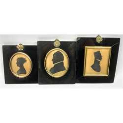 19th Century silhouette profile portrait of a gentleman wearing a top hat 9cm x 7cm another inscribed on the reverse 'Charles Perigal, Vicar of Ellingham' died 1854 and one other silhouette  (3)