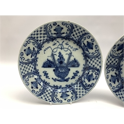 Pair of 18th century Delft blue and white chargers, centrally painted with a vase of flowers, the borders with hatched panels divided by foliage D31cm
