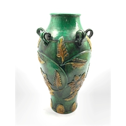 Chinese provincial wine vessel with ring handles, yellow leaves on a green ground H37cm
