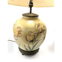 A near pair of glass table lamps having floral decoration on lustre ground, with pleated shades, H66cm max