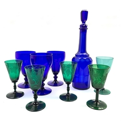 Three Georgian green wine glasses the bowls etched with fruiting vines, a matching wine glass, 19th century Bristol Blue glass decanter, three Bristol Blue glass rummers, etc