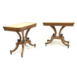 Pair of early 19th century crossbanded walnut tables for tea and cards with fold over tops, inverted scroll cluster columns and quartette splay supports W92cm