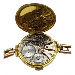 Swiss 18ct gold manual wind wristwatch, case by Stockwell & Co, London import marks 1919, on gold expanding strap stamped 15ct