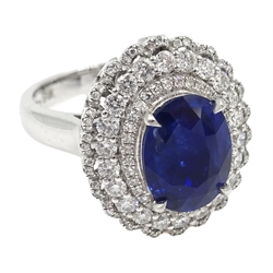 18ct white gold oval sapphire and diamond cluster ring/pendant, sliding shank with hidden bail, stamped 18K, sapphire 3.62 carat