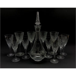 Part suite of Stuart Crystal Lichfield pattern glass comprising four large claret glasses and seven smaller and a Stuart crystal Ariel pattern decanter