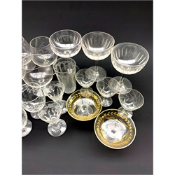 Collection of 19th century and later glassware including three faceted champagne bowls, two engraved and gilt short stemmed glass bowls, custard cups etc