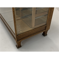 Early 20th century vintage oak haberdashery shop display cabinet, fitted with five banks of three glass shelves, raised on splayed block supports, W184cm, H92cm, D61cm