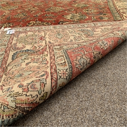 Persian Tabriz ground carpet, with interlaced foliate on red field, double guarded ivory border, 300cm x 345cm