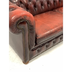 Late 20th century three seat chesterfield sofa upholstered in deeply buttoned red leather, W225cm, D98cm
