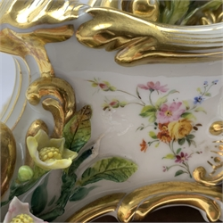 19th century Rococo style porcelain mantel clock, cartouche shaped with hand painted flower head and foliage decoration, on stand initialled 'J.P. (Jacob Petit)' engine turned silvered Roman dial, twin chain movement striking on bell, signed on back plate 'Douillon 2313,' 'Pepin Paris,' gilt wood and gesso stand decorated with shells and floral swags, ebonised plinth, under glass dome, H59cm