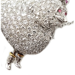 Platinum poodle brooch pave set diamonds, cabochon ruby eyes and calibre cut ruby bow, stamped P.T