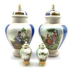 Pair of Continental Helena Wolfsohn style vases and covers H29cm together with a pair of similar style miniature jars and covers, unmarked (4)